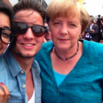 "A Kosovar's Selfie with Angela Merkel becomes the photo of the year in Switzerland's ""20 Minutes"""